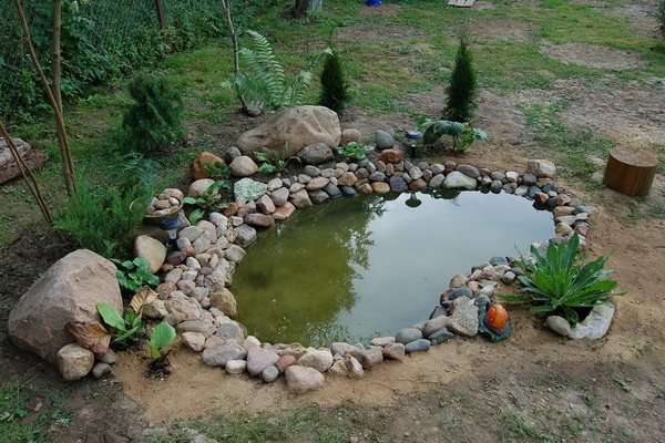 Мельница из камней для сада своими руками 229